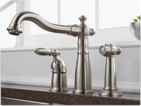 delta faucet victorian single handle kitchen sink faucet  side sprayer  matching finish