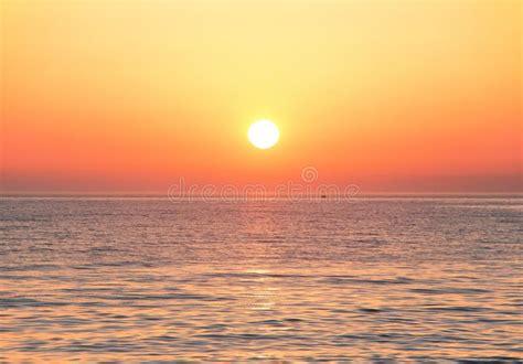 Black Sea At Sunset. Large Yellow Sun Under The Sea ...