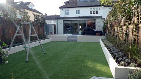 modern sleak garden  maintenance high impact garden design raised white wall beds grey