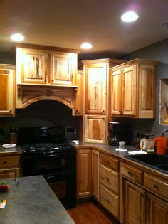 picture of kitchen cabinets what granite choice with hickory cabinets 4189