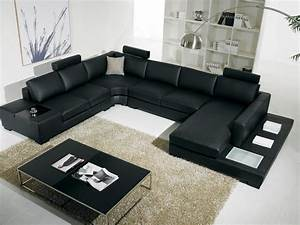 Modern black leather sofa for living room design 2012 for Sectional couch living room layout