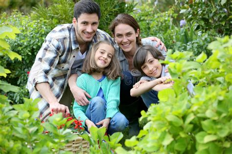 Portrait Of Happy Family In The Garden Stock Image Image