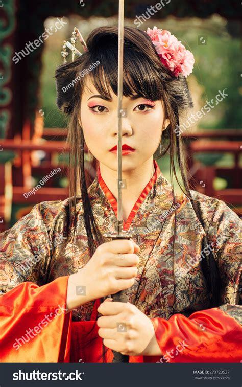 beautiful korean woman geisha kimono holding stock photo