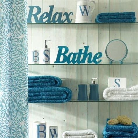 cool teal bathroom glass shelves  white   words
