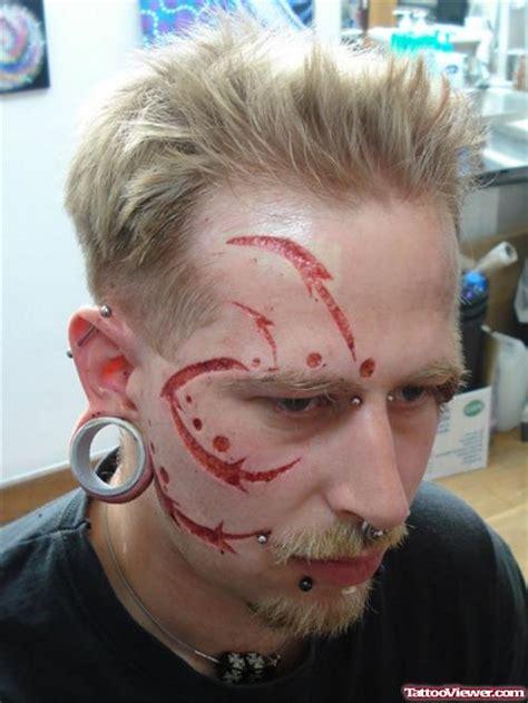 unique scarification tattoos designs