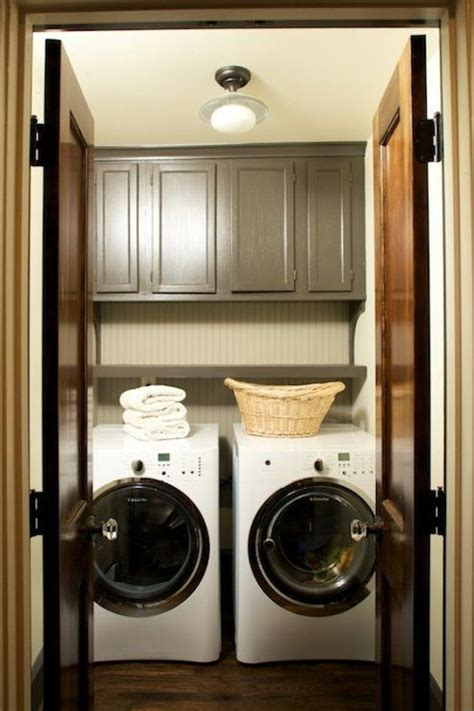 cabinets over washer and dryer cabinets over washer dryer transitional laundry room