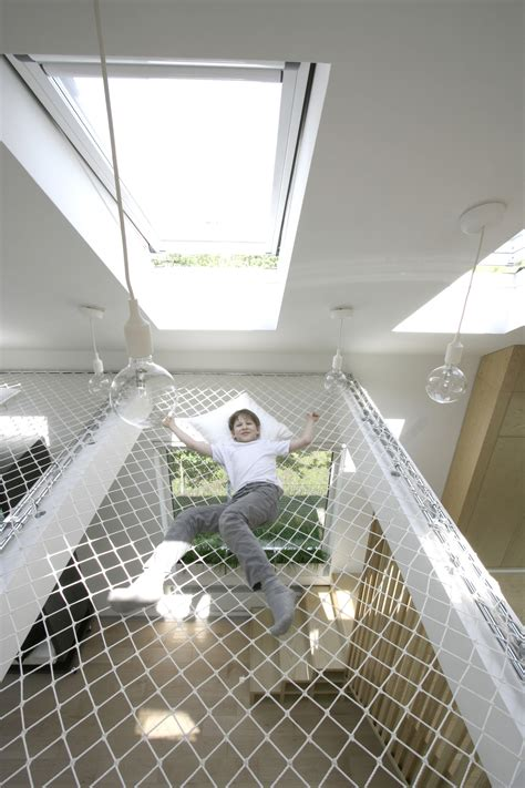 Hammock From Ceiling by A Design Transforms A Studio Into A Work And