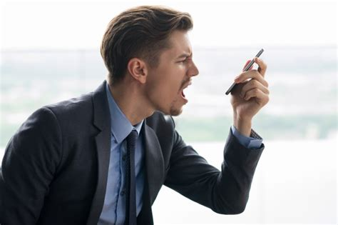 Indignant Adult Businessman Angry At Smartphone Photo