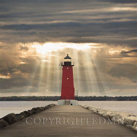 manistique lighthouse sunbeams manistique michigan
