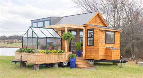 Tiny Mobile Home Is Equipped With A Flourishing Green House