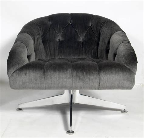 pair of charcoal gray velvet swivel chairs designed by