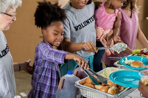 how to teach about charity 728 | little girl volunteers with her family at a soup kitchen 624441786 5939fcda5f9b58d58a13b399