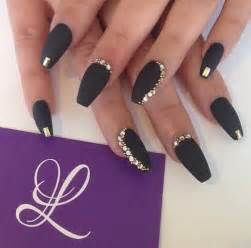 Black and gold nailart image by lauralai on
