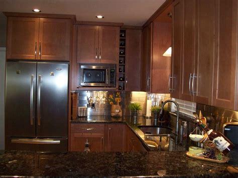 remodeled kitchen  stainless steel backsplash