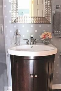 18 small bathroom ideas to make this cozy space look With how to make a small half bathroom look bigger