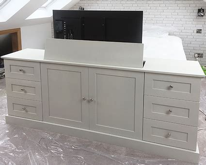 bedroom wall unit tv cabinet with lift popup end of bed bespoke