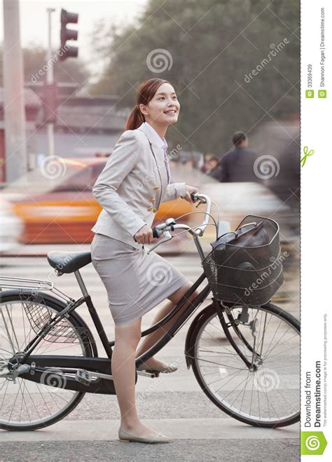 young business woman commuting   bicycle beijing