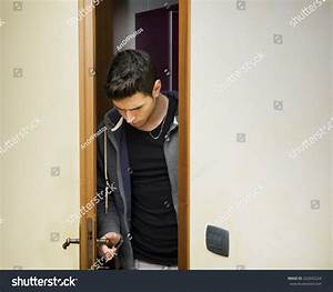 Handsome Young Man Opening Door To Enter Into A Room ...