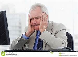 Upset Senior Manager Working With A Monitor Stock Image