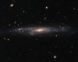 Hubble Sees Galaxy Hiding in the Night Sky | NASA