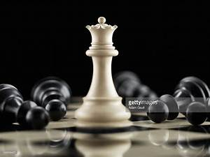 White Queen Chess Piece Surrounded By Fallen Black Pawn ...