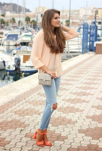 Picture Of With peach blouse jeans and mini bag