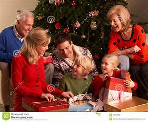 Three Generation Family Opening Christmas Gifts Stock