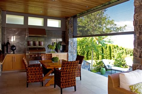 Screen Porch With Fireplace by Retractable Screens Bring Outdoor Living Okanagan Style