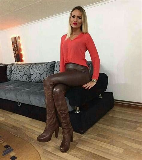 Amateur In Brown Leather Pants And Otk Boots Seated On