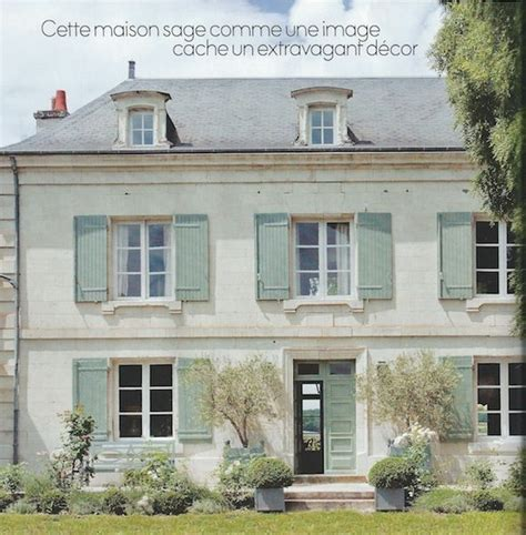 manor beautiful light stucco sloped roof and blue shutters gorgeous