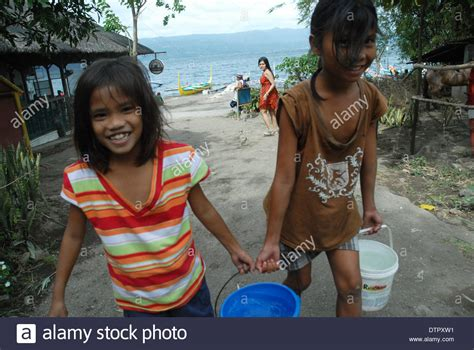 Girls Carrying Water Taal Volcano Luzon Philippines
