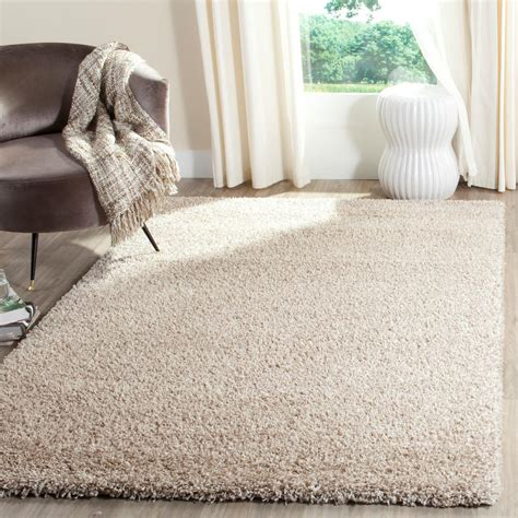 beige and white rug safavieh california shag white beige 6 ft 7 in x 9 ft 6