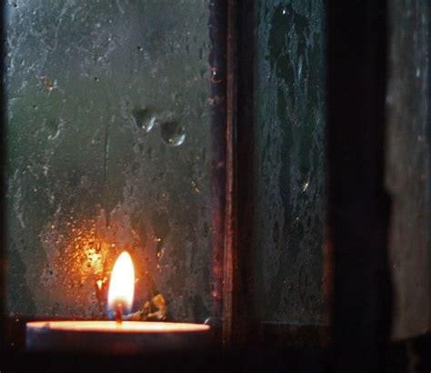 candle window candles light rainy rain dark days night windows christmas lanterns burning candlelight fear lights guide modern hospitality ancient