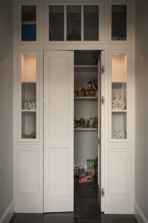 kitchen pantry cabinet with glass doors walk in pantry with bi fold doors flanked by built in 9528
