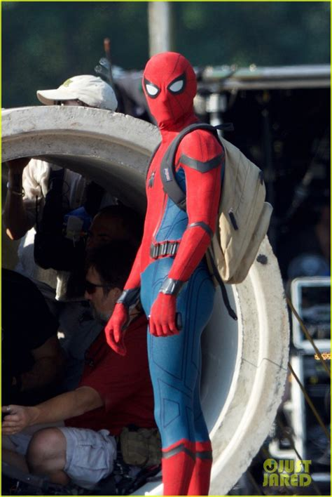tom holland wears spider man costume   time