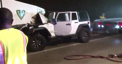 man injured  jeep crashes  street sweeper vehicle