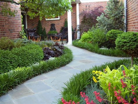 plants for walkway landscaping ideas flagstone path with liriope border in the ford courtyard garden perennial garden pinterest