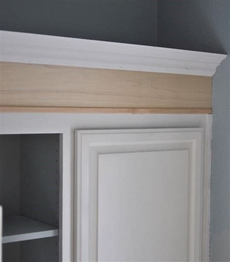 adding tall crown molding then painting cabinets. Link to