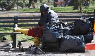 homeless men hunting  eating park pigeons