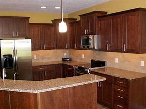 Note cherry wood cabinets light granite and gold wall for Kitchen cabinets lowes with brown and gold wall art
