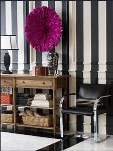 black and white striped walls eclectic entrance foyer With kitchen colors with white cabinets with african juju hat wall art