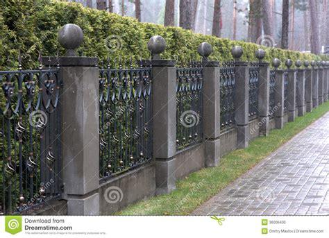 iron fence  stone pillars stock photo image