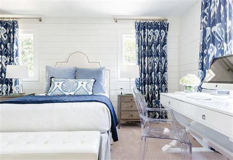 white and blue bedroom with ikat curtains transitional
