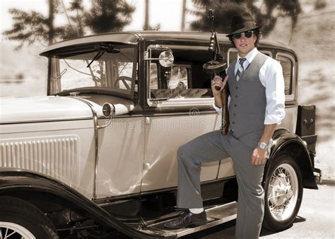 Gangster With Gun And Old Car Stock Photo