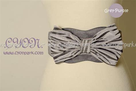 fashion belt motif animal dari cyon park di pakaian wanita