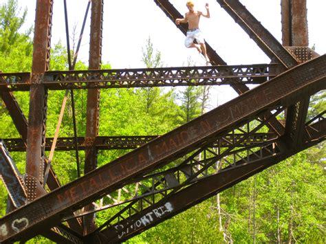 jumping    train bridge menominee river michigan