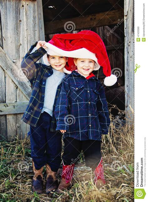 boys wear cowboy boots and christmas hat stock photo image 47433390