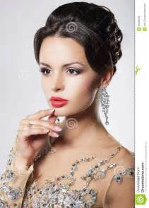 s earring prices woman with evening hairstyle and earrings royalty