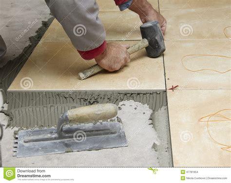Thin Set Mortar For Porcelain Tile by Home Improvement Renovation Construction Worker Tiler