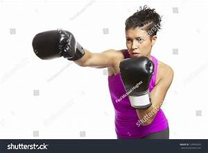 Young Woman Boxing Gloves Throwing Punch Stock Photo ...